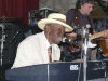 Pinetop Perkins sitting in